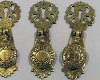 Antique brass combination keyhole door cover plate escutcheon with a pull