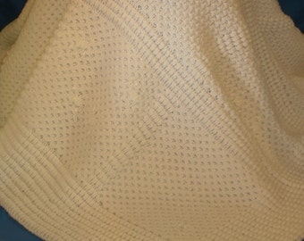 baby blanket made in a loom and hand embroider