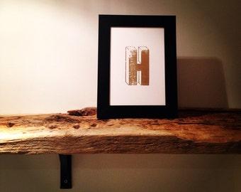 Framed gold letter H (letterpress print)