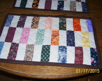 Scrappy quilt, place setting.