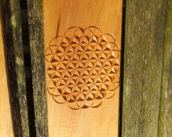 wood carving using sacred geometry flower of life created using traditional swiss technique
