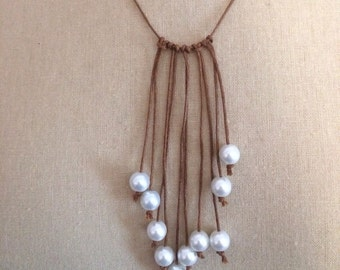 Knotted seaside pearl strand necklace on brown leather string