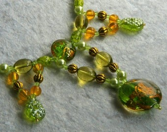 Necklace in green and yellow glass beads