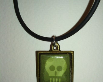 """Green Square Skull necklace comes with 23"""" silky rubber cord"""