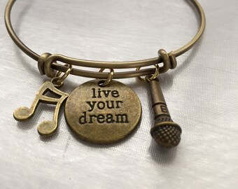 """Music-Antique bronze bracelet with music note microphone and stamped """"live your dream"""""""