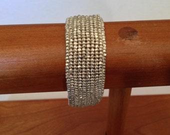 Silver seed bead bracelet.