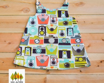 Retro camera toddler dress. Reversible dress with orange and sky blue modern print toddler dress. Michael Miller Fabric