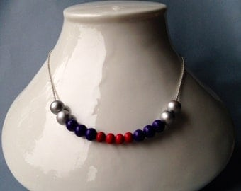 Silver necklace adorned with hand-painted wood beads.