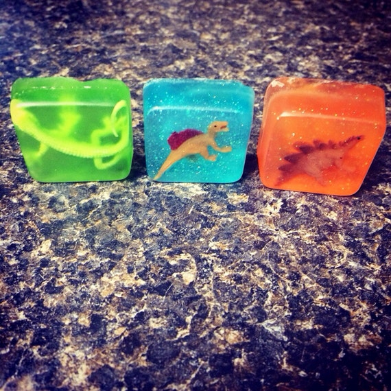 1.25 inch square mini soap orange scent with toy dinosaur or lizard inside!