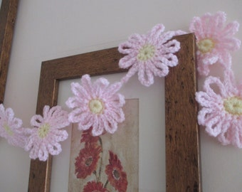 Crocheted pink daisy bunting