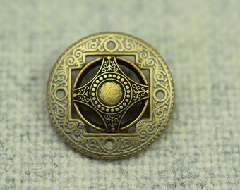 Gold bronze metal button with oriental shield motif