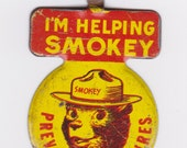 Vintage 1960's Smokey The Bear tin foldover tab button (v-002)