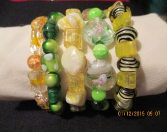Colorful bracelet, greens and yellows, layered look, glass and plastic beads