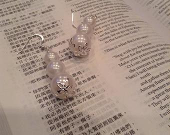 Pearl earrings. White earrings. Fancy earrings. Dangle earrings.