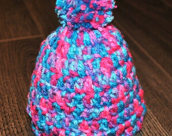 Multicolored baby crocheted hat with pom pom