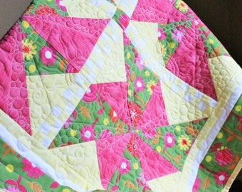 Handmade baby quilt in bright and fun pinwheel pattern all cotton baby quilt