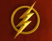 Full-sized, Flash costume 3D printed lightning bolt insignia.