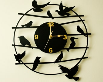 Laser cut acrylic wall clock.