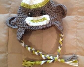 Crocheted sock monkey hats