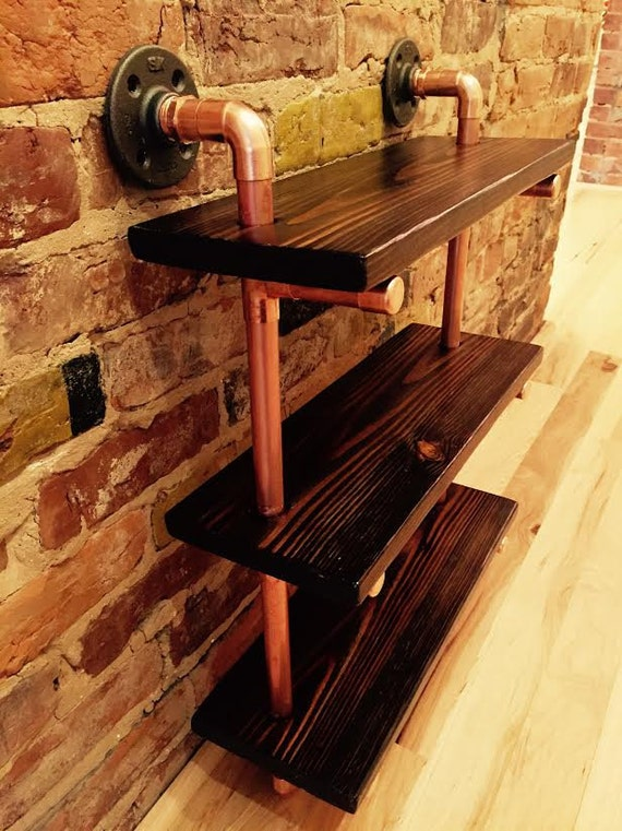 Pipe and reclaimed wood shelves