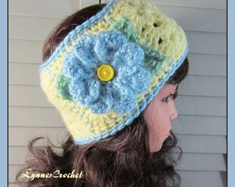Crocheted Yellow Granny Square Headband with a bright Blue Flower . .