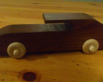 Hand made wooden toy car.  Finish is child safe.