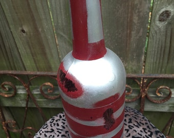 sliver and red distressed bottles