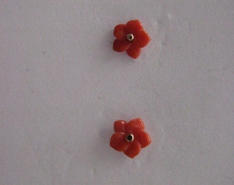 coral carved flower earrings in 18kt gold and snap also 18kt .
