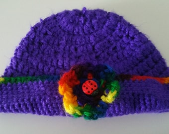 Purple crochet hat with multicolored flower