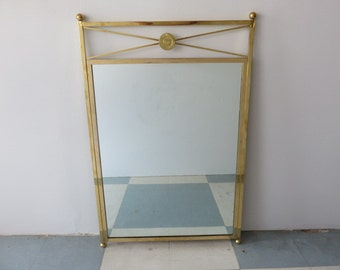 Modernist And Elegant Mid-Century Modern Solid Brass Mirror In The Manner Of Jean Royere.