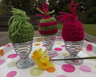 Crochet egg cosies. Set of three Lime green and fuchsia pink coloured egg cosies. Egg warmers.