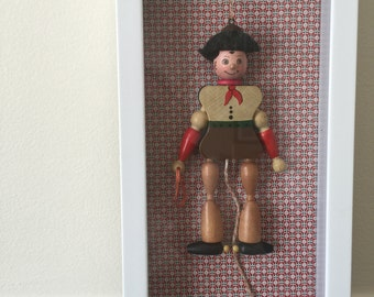 Shadow Box Art. White framed vintage wooden pull-string cowboy toy. Perfect for child's room, playroom, or nursery.