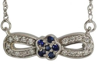 Flower Pendant In 14k White Gold With Diamonds And Sapphires In A Bow Design