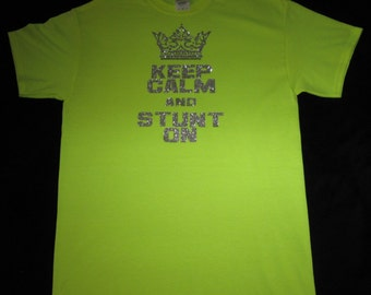 Custom Cheer Shirt in Flroescent Yellow and is a Medium, Keep Calm and Stunt On is on the Front in Silver Glitter