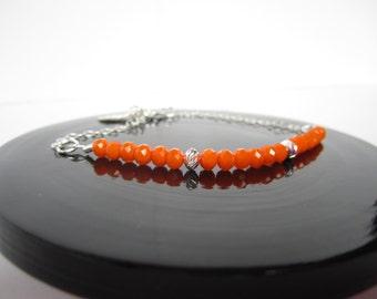 Bright orange bracelet with brushed sterling silver beads
