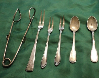 Silver teaspoons forks clamp