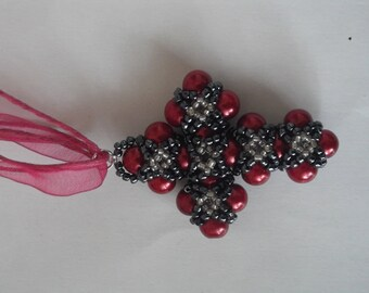 Cross from glass pearls and beads