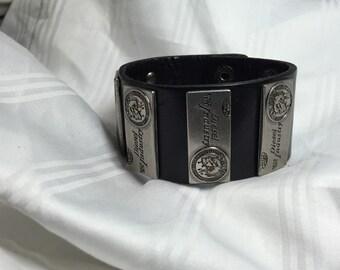 Leather bracelet with metal diesel strips