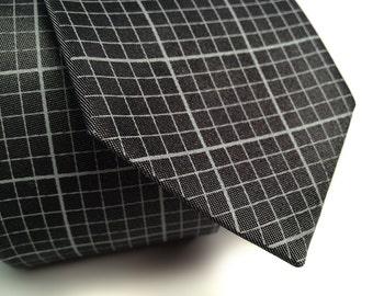 Graph paper necktie. Pewter shot silk. Silkscreened grid paper men's tie. Perfect designer, architect, math, engineer, or geek gift.