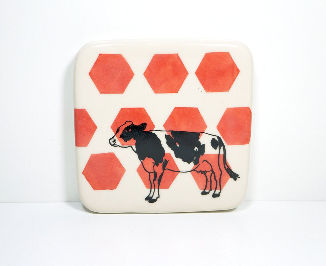 tile with a holstein cow on red-orange hexagons, made to order / pick your colour