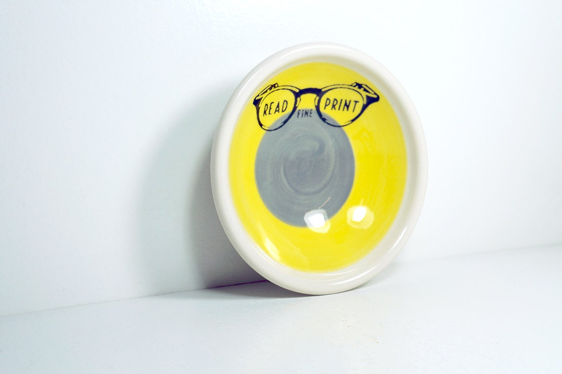 """small dish, with a """"Read Fine Print"""" sign on a color block of yellow & storm, made to order."""