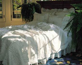 vintage white grape cluster quilt designed by judi boisson . white on white trapunto cotton quilt dimensional grape clusters twin size