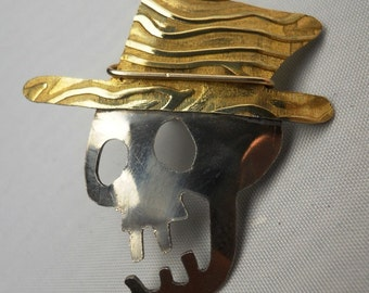 Skull with Hat Tack