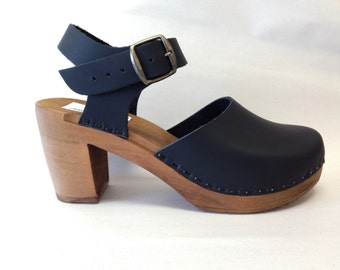 Black oiled Mary Jane on a brown super high heel w/ buckled ankle strap