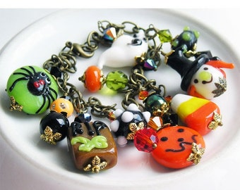 HOLIDAY SALE 35% OFF  - Halloween Charm Bracelet, Lampwork Glass Swarovski Crystals, Witch Ghost Rip Pumpkin Candy Corn Spider, Orange Black