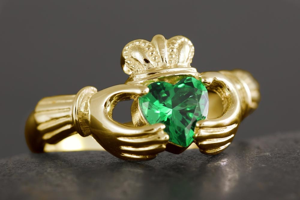 gold claddagh ring with a emerald color cubic by vanseejewelry
