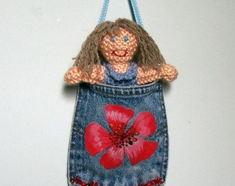 Recycled denim pocket with hand knit doll