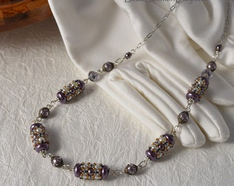 Beadwoven necklace with pearls in purple