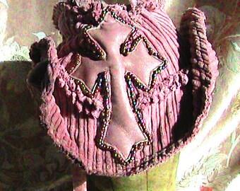 tattered pink beaded cross hat