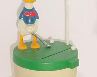 Donald Duck - Mechanical Type Bank - Golfing Donald - 1981 Paragon Reiss